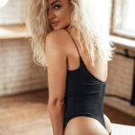 Seductive And Elegant Young Female Model With Blond Curly Hair,